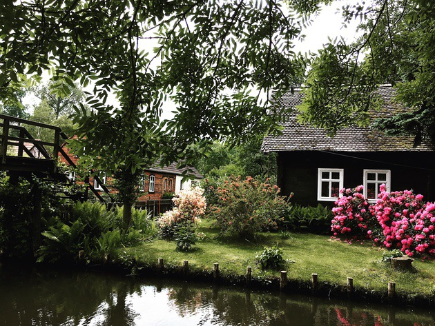 iPhone photography tips: An iPhone photo of a wooden house by the river