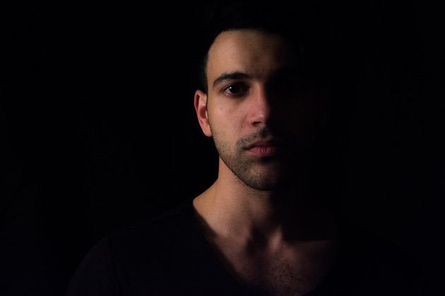 Portrait shot of a young man in the dark